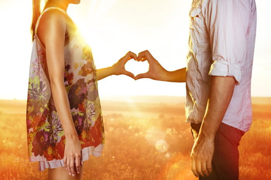 couple making heart shaped hands