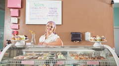 A baker owner behind the counter.