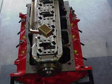Le Coupe 331 Stroker Bottom End. Notice the DSS Racing Aluminum Gridle and corresponding Aluminum Windage Tray. The crank is a Scat 9000 and I used ARP Studs to secure the crankshaft. The oil pickup is part of the Canton Road Racing Oil Pan setup.
