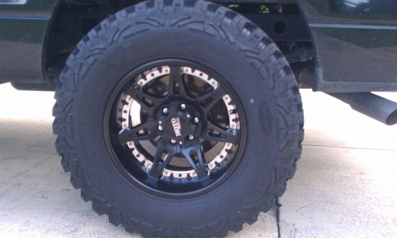 "Moto Metal 961's 18x10 wrapped in 35"" ProComp Xtreme mud terrians"