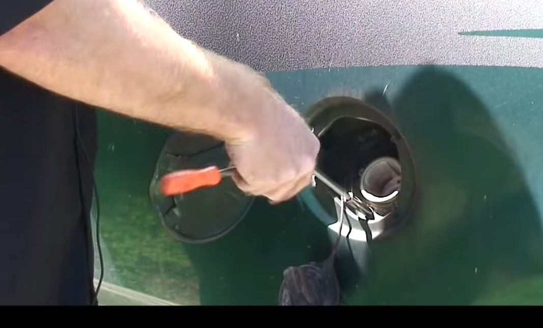 Figure Disconnecting Fuel Filler Cap