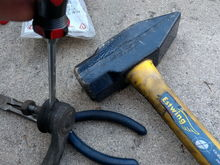 Remove the old, dried out, rotten boot using a standard screwdriver and hammer.