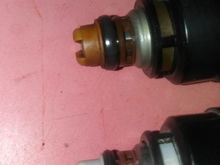 Gap between pintle cap and plastic piece above lower o-ring