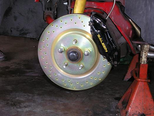"""new brembo 13"""" cross drilled rotors up front with matching 10 1/2 drilled in the rear"""