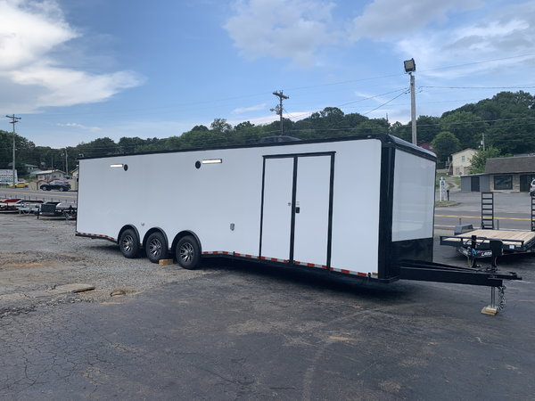 NEW 2020 OUTLAW ENCLOSED RACE TRAILER- triple spread axle  for Sale $26,995