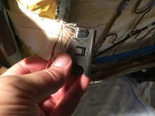 Slide this clip off, then remove the material and reattach the new seat cover...