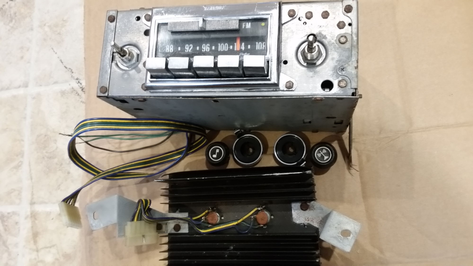 F/S 1974 Stock AM / FM radio, knobs, amp, wiring harness ...