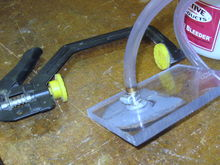 """1/2"""" thick Lexan.  Large clamp to hold plate onto MC."""