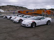 Photo-op at '07 Laguna Seca ALMS. Mine is on the far left. There was actually a 6th one there, Ron Fellows' #001 was in the Corvette Corral display tent. The Reliable truck was carrying the yellow ZR1 that Johnny O' did two quick laps in.