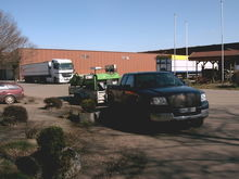truck and trailer loaded with the seed potato cutting machine
