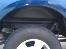 Passenger side rugged wheelwell liner
