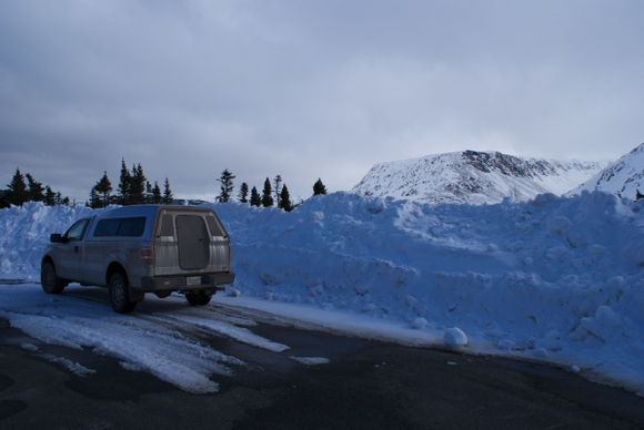 DSC04742-March 31 and the snowbanks on the side of the road are still higher than the truck; in summer the slope is DOWN from the road shoulder.