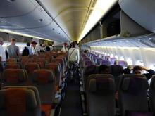 Emirates 777 Y cabin on boarding.