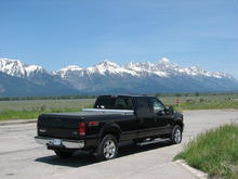 Black in front of the Grand Tetons outside of Jackson Hole, WY