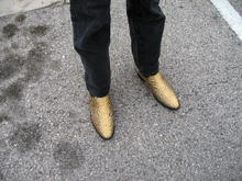 "The famous ""Gold"" boots (only they are python skinned.)